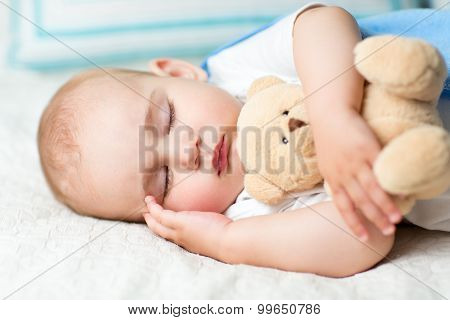 baby sleeping on bed