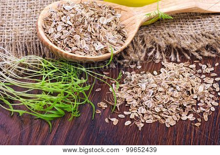 Dill Seeds On A Wooden Spoon On Wood