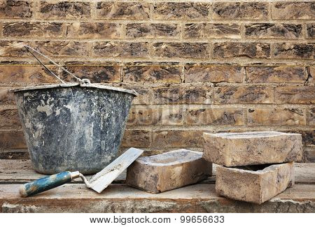 Vintage style brickwork and construction's tools. Masonry brickwork concept