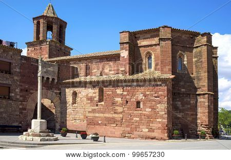 a side view of the gothic church of Santa Maria in Prades, Spain