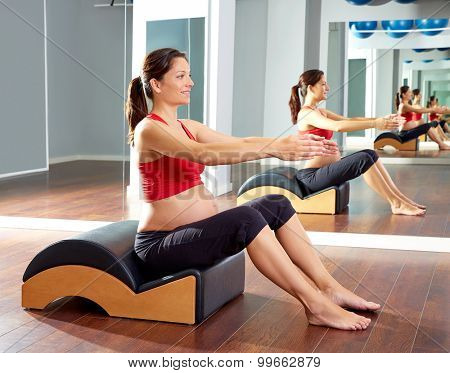 pregnant woman pilates exercise with spine wave corrector