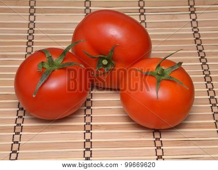 Tomatoes On A Natural Bamboo Table Mat