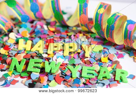 Happy New Year label with colorful confetti poster