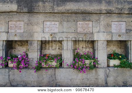 Memorial plaques honor French soldiers who were killed on Liberation Day