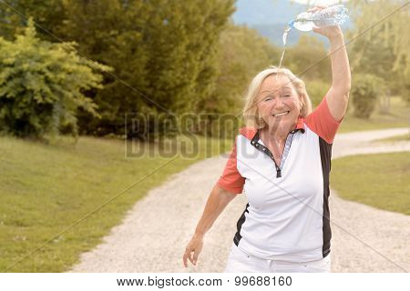 Happy Vivacious Woman Cooling Down With Water