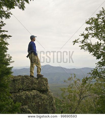 A Man Gazes At The Mountain Horizon