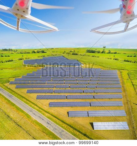 Aerial view to solar power plant.  Use drones to inspect electric infrastructure. Modern technology theme.