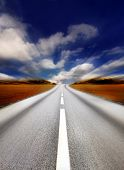 highway in the countryside/motion blur focus at the road poster