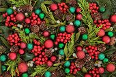 Christmas abstract background with red and green bauble decorations, holly, ivy, mistletoe, blue spruce fir and cedar cypress greenery. poster