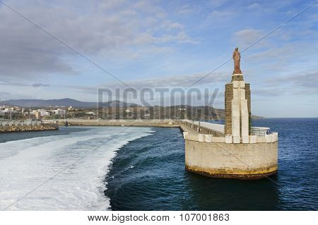 Jesus Christus statue at the port entrance in Tarifa, Spain