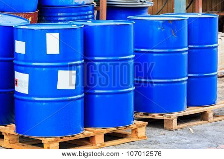 Many Blue Barrels On Wooden Pallets