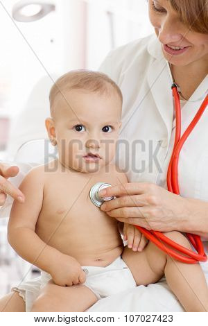 pediatrician doctor with baby in medical room