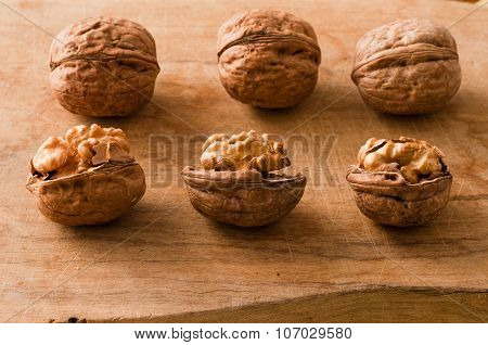 pile of walnuts in the foreground represent a healthy diet poster