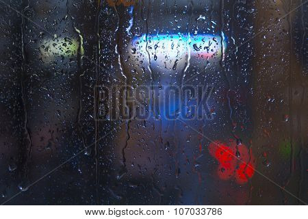 Rain drops on window - night light