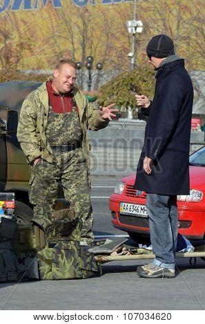 KIEV , UKRAINE - NOV 1, 2015. Flea market in downtown. Marauder sale Ukrainian  Civil War military items. November 1, 2015 in Kiev, Ukraine