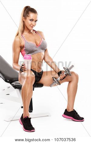 Nice Sexy Woman Sitting On A Bench And Workout With Dumbbell