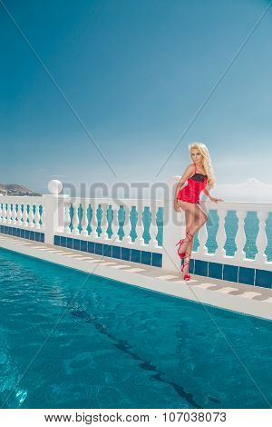 Beautiful Blond Hair Model Sexy Woman Standing At The Pool Of Short Red Valentine's Erotic Lingerie