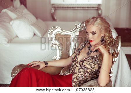 Elegant Lady. Fashion Beautiful Sensual Blond Woman With Makeup In Luxurious Prom Dress With Bijou,