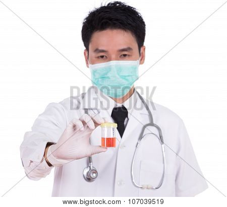Doctor's Hand Holding A Bottle Of Bloody Urine Sample