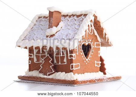 lovely gingerbread house on white - sweet food