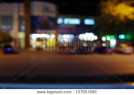 Night Urban Scene With Blurred Lights And The Shopping Center