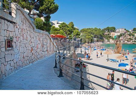 Stone walkway and sandy beach