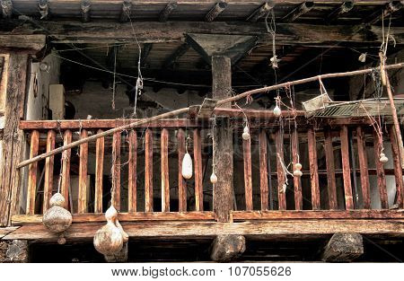 Old wooden balcony with hanging pumpkins Extremadura Spain poster