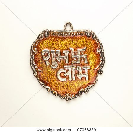 'Shubh Labh' - An auspicious Indian slogan. Translation : 'Auspicious' and 'Profit'. Isolated metal plaque.