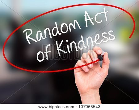 Man Hand writing Random Act of Kindness with black marker on visual screen.