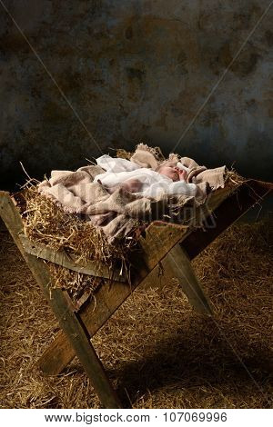 Baby Jesus in the manger with a dark background