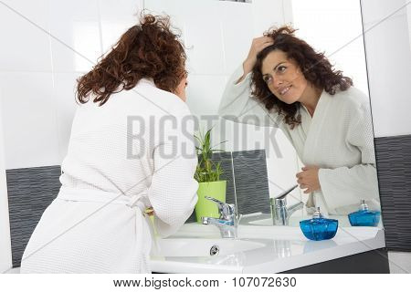 Woman At Her Bathroom In The Morning