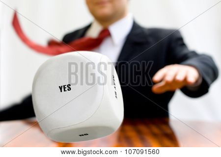 Businessman throwing the dice to make a decision