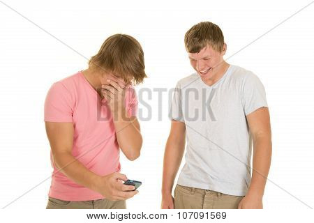 Two Boys Laughing Looking At Phone