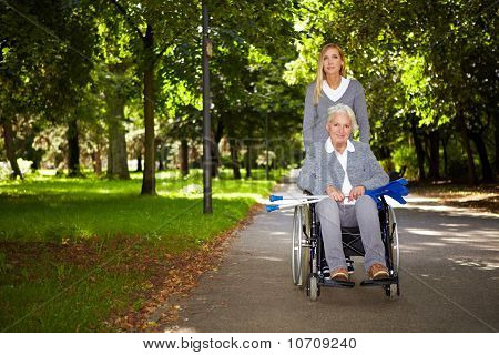 Woman In Wheelchair Driving In Park