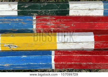Colorful Wooden Barriers On The Ground For Jumping Horses As A Background