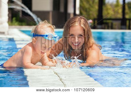 Baby Boy With Mother Swimming With Fun In The Pool