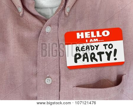 Hello I Am Ready to Party words on a name tag worn by person in pink button shirt