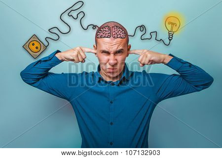 businessman man plugged his ears with your fingers does not want