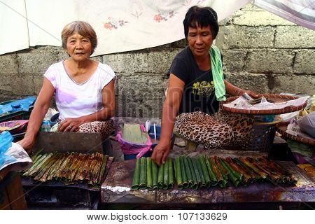 Market vendors sell local delicacy snack known as
