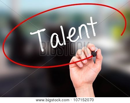 Man Hand writing Talent with black marker on visual screen.
