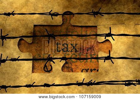 Tax Puzzle Concept Against Barbwire