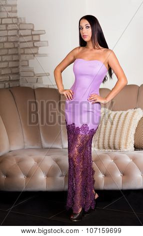 Woman In Pink Dress In Luxury Interior.