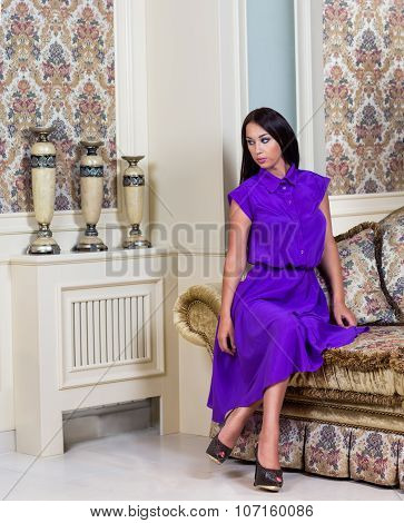 Beautiful Woman In Purple Dress In Luxury Interior.