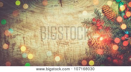 Christmas tree with lights on wood background