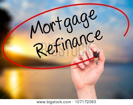 Man Hand writing Mortgage Refinance with black marker on visual screen.
