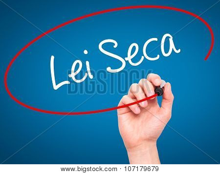 Man Hand writing Lei Seca (Prohibition Alcohol Law n Portuguese) with black marker on visual screen.