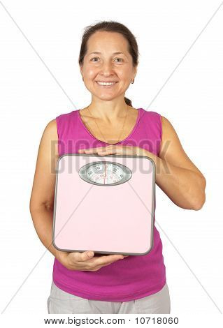 Happy Mature Woman Holding Scale