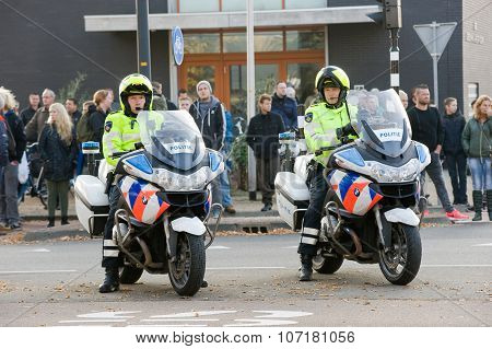 Policemen On Motorcycles