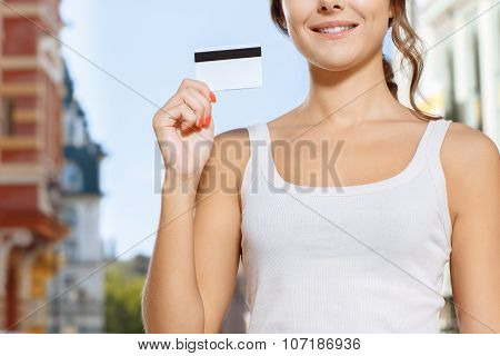 Close up of woman holding credit card