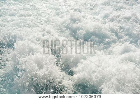 Turbulent Chaotic White Spray Of Sea Foam And Blue Sea Salt Water